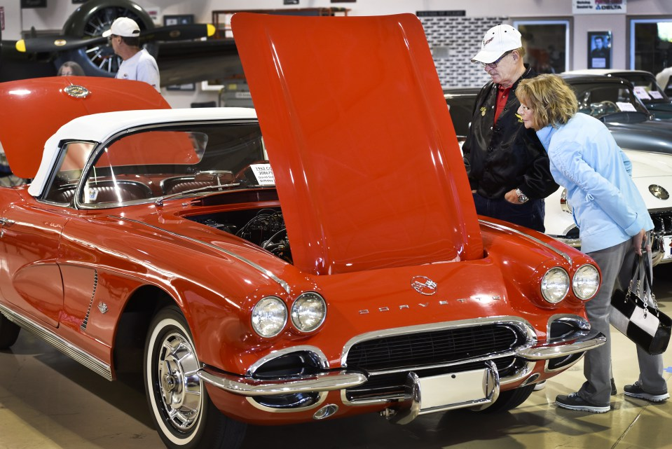 Dave and Sherry Marston of Cambridge look over a 1962 Corvette at the 2016 Regional Judging Meet of the National Corvette Restorers Society at the Canadian Warplane HEritage Museum.  They have a 1961 Corvette at home. John Rennison The Hamilton Spectator 9/24/16