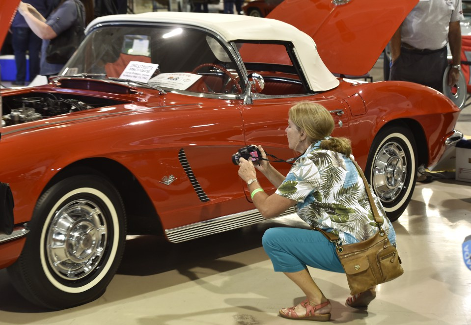Barb Brooks of Ottawa photographs a 1962 Corvette at the 2016 Regional Judging Meet of the National Corvette Restorers Society at the Canadian Warplane Heritage Museum.  She has a 1966 Corvette at home. John Rennison The Hamilton Spectator 9/24/16