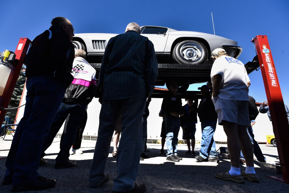 Enthusiasts gather around a 1967 Corvette as what makes a car an original is explained at the 2016 Regional Judging Meet of the National Corvette Restorers Society at the Canadian Warplane Heritage Museum.   John Rennison The Hamilton Spectator 9/24/16