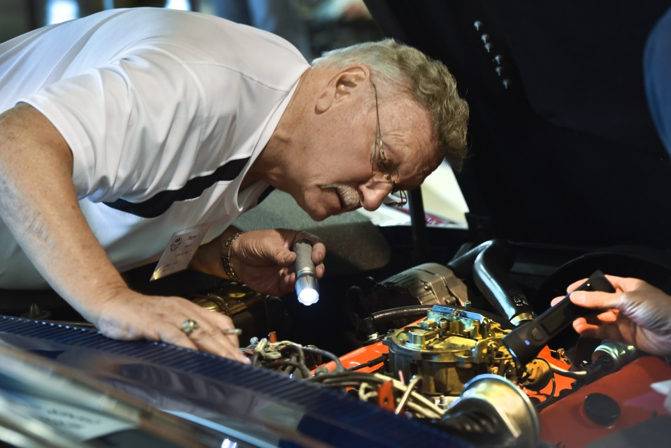 Judge Roger Zrimsek goes over the engine of a 1971 Corvette he was judging at the 2016 Regional Judging Meet of the National Corvette Restorers Society at the Canadian Warplane Heritage Museum. John Rennison The Hamilton Spectator 9/24/16